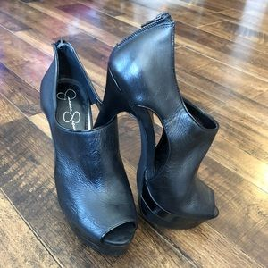 Black leather ankle booties by Jessica Simpson
